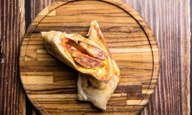 Pizza e sanduíche com a deliciosa linguiça caipira são as novidades do mês na Grano & Oliva e Inforno Burger